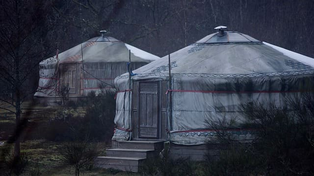 Two yurts in the wild want bathrooms kitchen and the toilets